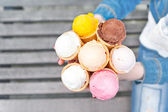 Many different colors ice-cream in waffles. — Stock Photo
