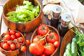 Tomatoes, salad and cucumbers-vegetables for picnic. Outdoors. — Stock Photo