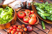 Tomatoes, salad and cucumbers-vegetables for picnic. Outdoors. — Stok fotoğraf