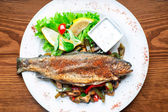 Grilled trout with fried vegetables and lemon. Main course. — Stock Photo