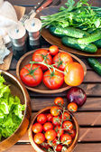 Homegrown vegetables in wooden dishware for spring picnic. — Stock Photo