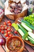Vegetables and barbecue meat on spring weekend picnic. — Stok fotoğraf