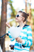 Smiling girl with cotton candy in summer park. Treat and happiness — Stock Photo