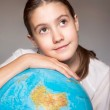 Back to school. Dreaming smiling girl with blue globe. Childhood — Stock Photo #51764837