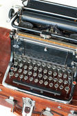 Old retro black metallic typewriter with antique round  keys. — Foto Stock