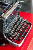 Old retro black metallic typewriter with antique round  keys. — Foto Stock