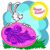 Bunny with patterned easter egg — Stock Vector