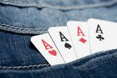 Poker in jeans pocket — Stockfoto