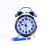 Alarm Clock with pen — Stock Photo
