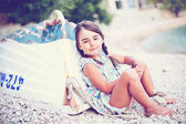 Little pretty girl near the boat on the sea coast — Stock Photo