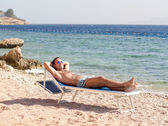 Resting man on a beach — Stock Photo