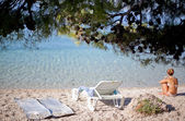 Resting woman on the beach in Croatia — Stock Photo