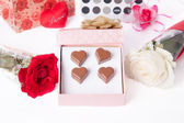 Heart Shaped Chocolate Love in pink gift box and Roses Valentines Day — Stock Photo
