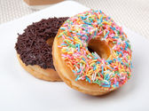 Colorful and chocolate Donut in white plate — Stock Photo