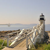 Marshall Point Lighthouse Port Clyde Maine with sailboat — Stock Photo