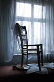 Chair by the window — Stock Photo
