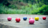 Bubble gum balls in the forest — Stock Photo