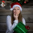 Pretty Santa Girl Thinking. New Year Gift. — Stock Photo #37830335