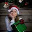 Pretty Santa Girl Thinking. New Year Gift. — Stock Photo