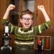 Stock Photo: Little boy making science experiments. Education.