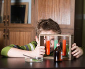 Young boy performing experiments. Little scientist. — Stock Photo