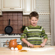 Little boy in the kitchen preparing the dough using rolling. — Stock Photo
