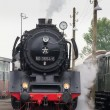 Historic steam train is driving into station — Stock Photo #39515843