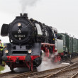 Editorial use only. Historic steam train is driving into station form maintenance — Stock Photo #39516247
