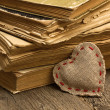 Heart and old books — Stock Photo