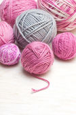 Balls of pink and gray yarn — Stock Photo