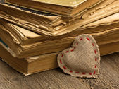 Heart and old books — Stock fotografie