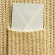 Stock Photo: White envelope (letter) in the pocket
