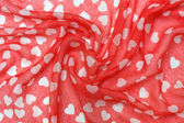 Fabric background with hearts — Stock Photo