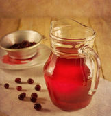 Cranberry drink in a glass pitcher — Stock Photo