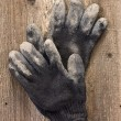 A pair of work gloves on the old wooden background — Stock Photo #39689301