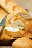 Pieces of baguette with sesame seeds — Stock Photo