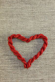 Red heart with threads — Stockfoto