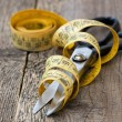 Scissors and measuring tape — Stock Photo #40013773