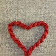 Red heart with threads — Stock Photo #41627021