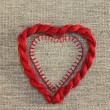 Red heart with threads — Stock Photo #41627043