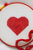 Heart embroidered cross — Stock Photo