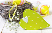 Easter decoration with  wooden heart — Stock Photo