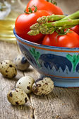 Tomatoes, asparagus, quail eggs — Stock Photo