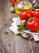 Tomatoes, asparagus — Stock Photo