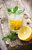 Glass with lemonade and mint — Stock Photo