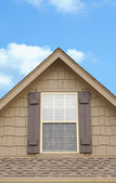 A roof gable above garage of house — Stock Photo