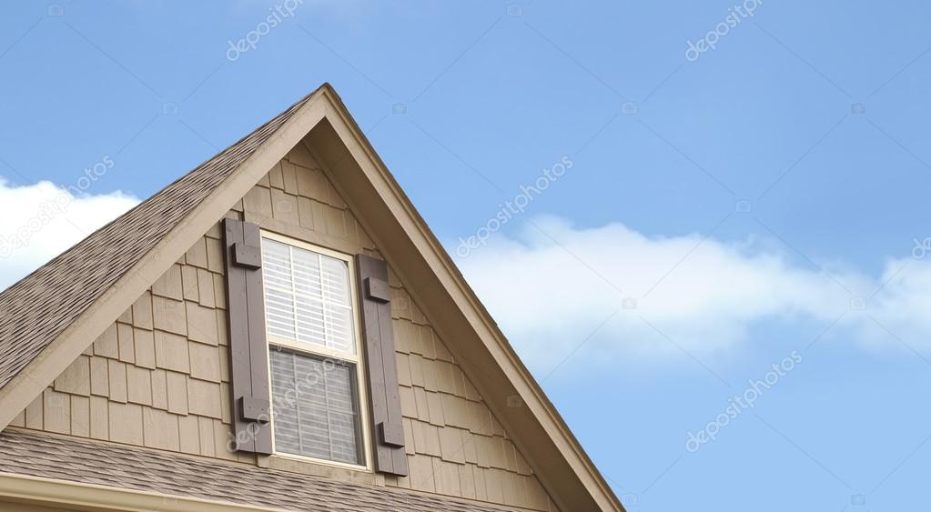 A Roof Gable Above Garage Of House Stock Photo