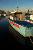 Fisherman's boat in the harbour of Trieste — Stock Photo