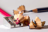 Sharpening a red pencil — Stockfoto