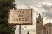 Sign in front of an italian church — Stock Photo